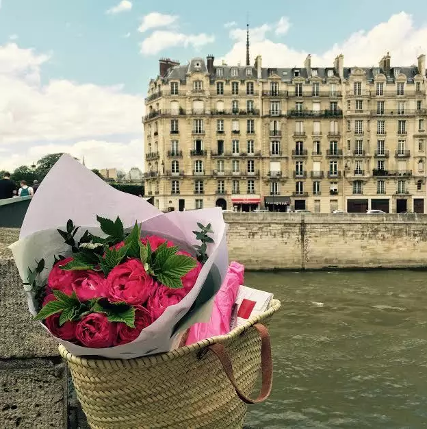 Delivering flowers and wine to guests on Ile Saint Louis.